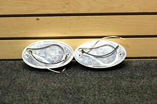 USED RV/MOTORHOME 2 PIECE OVAL ORANGE PORCH/DOCKING LIGHTS SIZE: 6-1/4 x 3-3/8